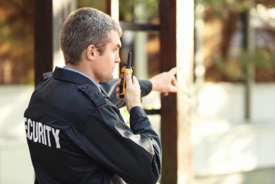 man holding a communicator device